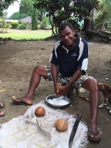Waspapa scraping coconuts