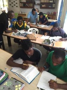 The guys hard at work, Oscar and Boniface (Mamusi translators) in the foreground.